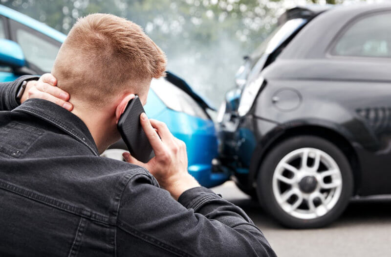 Image of person calling someone after traffic accident - Traffic Accident Injury Lawyers Hollywood FL