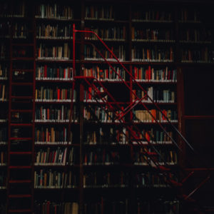 Image of book shelves in library by Personal Injury Law Firm
